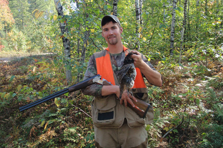 Cousin Chris with a grouse he shot with a 28-ga. White Onyx Dinner Gun bought at a DU event.